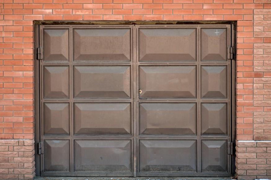 new garage door installation on brick home