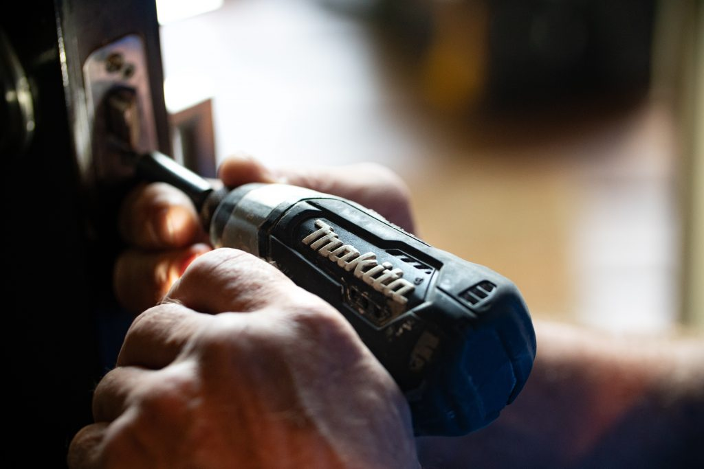 man using a Makita impact